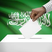 Ballot box with national flag on background - Saudi Arabia - stock photo