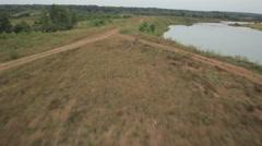 Motorbike rides on the lake Stock Footage