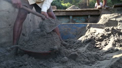 Man putting sand on a pile in a bowl with shovel. Stock Footage