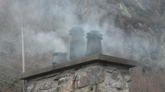 Smoke from Chimneys on a cottage Stock Footage