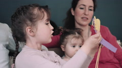 Mother helping girl in craft work Stock Footage