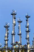 Detail of four distillation towers in a chemical plant and refinery with nigh Stock Photos