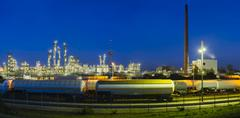 Panoramic view of a chemical plant and refinery with night blue sky and illum Kuvituskuvat