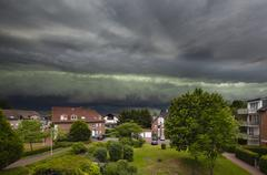 Approaching Thunderstorm Over Residential District - stock photo