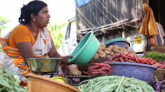 Woman at market stand with vegetable in Goa. Stock Footage