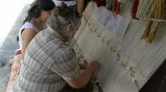 Turkish rug maker gives tourist lessons, Ephesus, Turkey - 4K 0225 Stock Footage