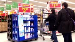 People shopping stuff inside Walmart store Stock Footage