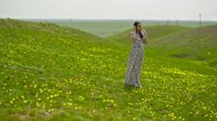 Woman in a Long Dress in a Meadow Stock Footage
