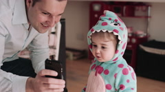 Father showing mobile phone to girl Stock Footage