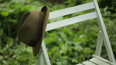 Stylish Hat on a Chair Stock Footage