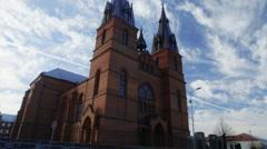 Catholic Church And Sky Tilt Up Stock Footage