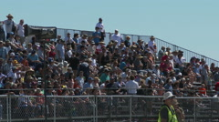Race fans in stands Stock Footage