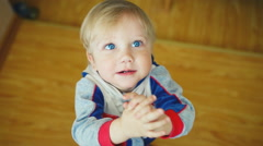 Kid baby child boy toddler asks for  toy and smiling Stock Footage