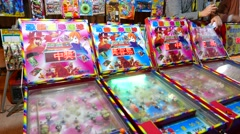 Classic ball gaming machine for children, colorful with chinese titles - stock footage