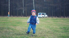 First steps of a small kid baby child boy toddler Stock Footage