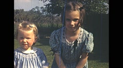 Vintage 16mm film, two girls posing for the camera, 1940 Stock Footage