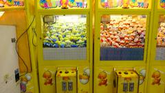 Claw catcher machine, standing in row at amusement shop, Shilin market area Stock Footage