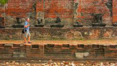Tourist Visiting an Ancient Temple Ruin in Ayutthaya, Thailand Stock Footage