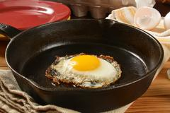 Fried egg in a cast iron skillet - stock photo