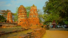 Ancient Stone Stupas near an entrance to Ayutthaya Historical Park in Thailan Stock Footage