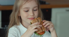 Girl eating a sandwich  Stock Footage