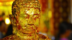 Buddha Statue Covered in Gold Leaf Offerings in Ayutthaya, Thailand - stock footage