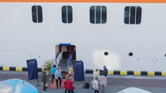 Timelapse of tourists leaving the cruise liner and going on sightseeing tours on Stock Footage