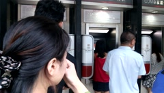 Shenzhen, China: ATM in banks queuing to get money - stock footage