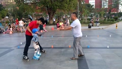 Chinese children are learning roller skating sports - stock footage