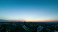 Sunrise over the city. The sun rises over the horizon of the sky. Timelapse - stock footage