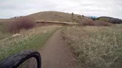 Mountain biker crossing wooden bridge in Colorado Stock Footage