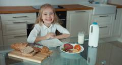 Portrait of a girl preschooler in the kitchen - stock footage