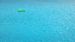 Raining at swimming pool - stock footage