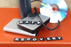 Data recovery from broken cd and lost info from hard drive Stock Photos