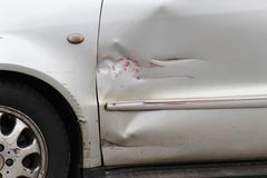 Red scratch on silver car door exterior Kuvituskuvat