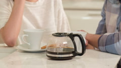 Young couple drinking coffee Stock Footage