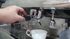 Barista making a shot of coffee espresso using a coffee machine Stock Footage