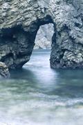 Rock with cavern Stock Photos