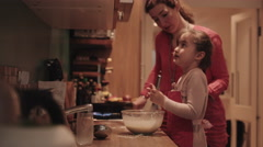 Mother and daughter making pancake Stock Footage
