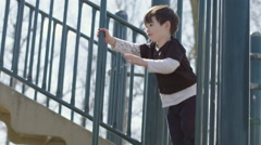 Mom helps her son sliding down from a climbing frame 4K Stock Footage