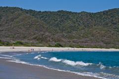 Unidentified tourists enjoying a daytrip in beautiful paradise beach, Salango Stock Photos