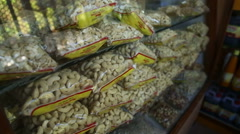 Cashew nuts sorted in plastic bags on shelves. Stock Footage
