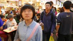Aisle on food court, asian faces, crowded area - stock footage