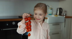 Child and little beautiful tomatoes. Thumb up. Ok Stock Footage