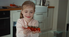 Child and little beautiful tomatoes Stock Footage