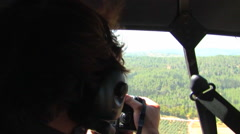 Aerial Photographer taking Pictures from Helicopter Stock Footage