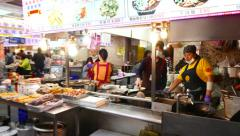 Walking in food court, look at cooking in different kitchen Stock Footage