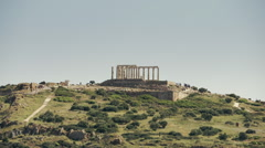 Greece people visit the Ancient temple of Poseidon at Sounio, long shot Stock Footage