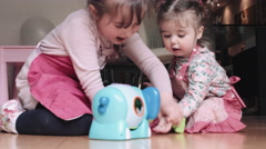 Girls playing with toy Stock Footage
