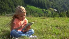 4K Child Playing Typing Tablet in Park, Little Girl Using Ipad PC, Camping Stock Footage